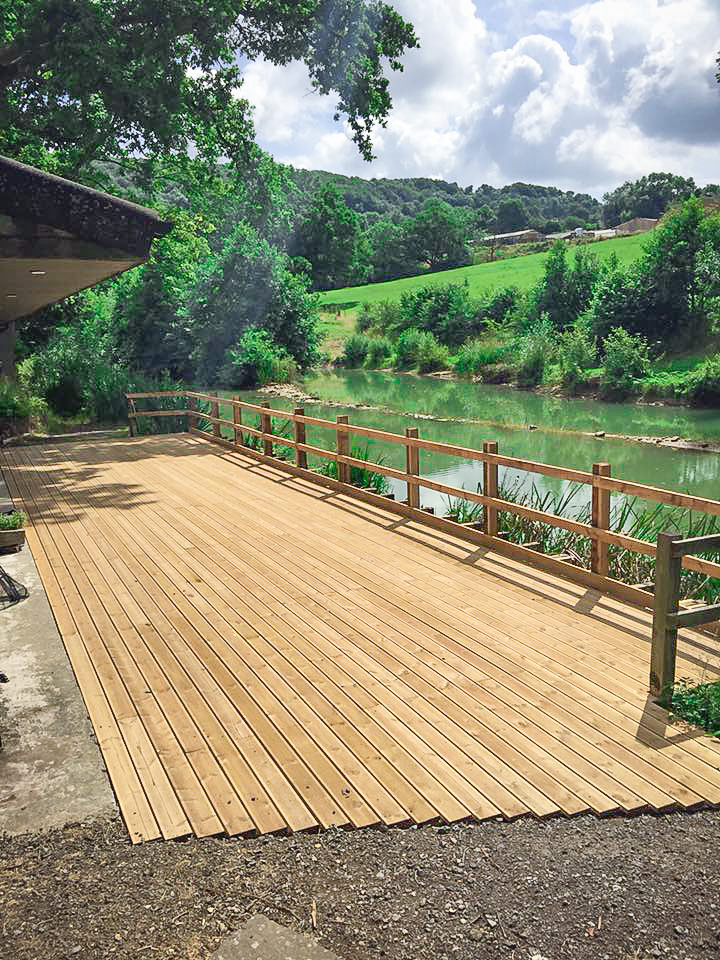 Painswick Glamping – Fishing Lodge deck and Mill Pool